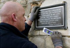 Fitting a plaque